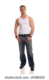 Casual young man in white undershirt and jeans.