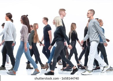 casual young people walking in different directions