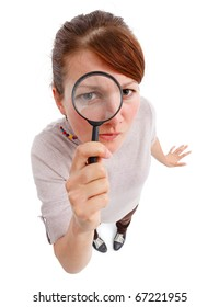 Casual young woman looking through magnifier lens as detective, analyzing or finding something