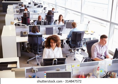 Casually dressed workers in a busy open plan office