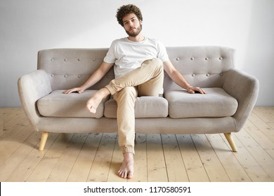 Man Sitting On Couch Cross Legged Stock Photos, Images ...
