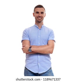 Casually handsome. Confident young handsome man in jeans shirt keeping arms crossed and smiling while standing against white background.