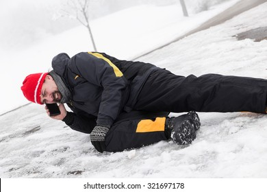 Casualty man on a icy street is calling the ambulance