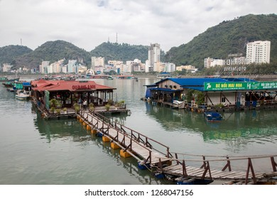 Cat Ba, Hai Phong, Vietnam - 11/22/2018:  Floating restaurant with Cat Ba Town in the background.