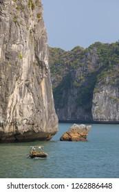 Cat Ba Island, Hi Phong, Vietnam - 11/22/2018:  Fishing boats on La Na Bay.