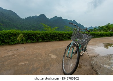 Cat Ba, Vietnam - 15th October 2019: A pushbike stood stationary against the beautiful backdrop of Cat ba Island on Ha Long Bay, Northern Vietnam