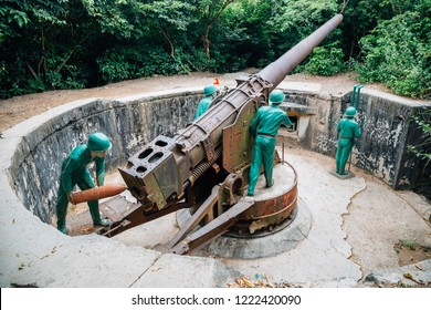 Cat Ba, Vietnam - October 18, 2018 : Soldier and cannon at Cannon Fort