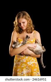 Cat and cute girl in orange dress