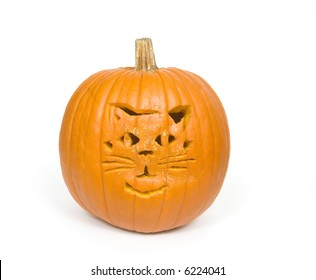 A cat face carved into a pumpkin for halloween