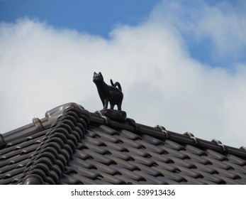 cat figure on the roof