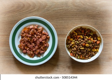 Cat food in bowl on a wooden backgrounds.