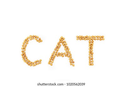 """Cat food in the form of the inscription """"cat"""" on white background"""