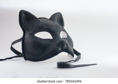 Cat mask for New Year's masquerade. Black matte with a pattern. At the outset