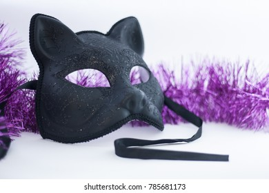 Cat mask for New Year's masquerade and tinsel. Black matte with a pattern. At the outset