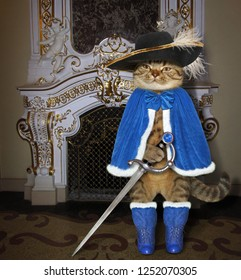 The cat musketeer in a blue cloak and a black hat with a feather holds a sword near a fireplace in the castle.