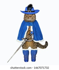The cat musketeer in a blue cloak, a hat with a feather and boots has a sword. White background. Isolated.
