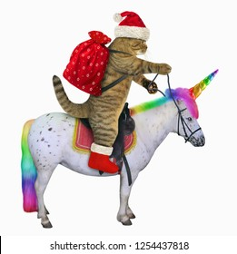 The cat in the Santa Claus outfit is riding the real unicorn. White background.