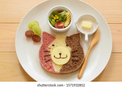 Cat Shaped Bread Slices On Wooden Background