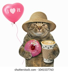 The cat in a straw hat holds a cup of coffee, a pink glazed donut and a balloon. White background.