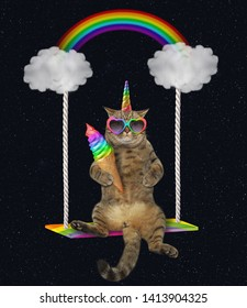 The cat unicorn in sunglasses with an ice cream cone  is riding on the cloud swing. The rainbow is behind him. Stars background.