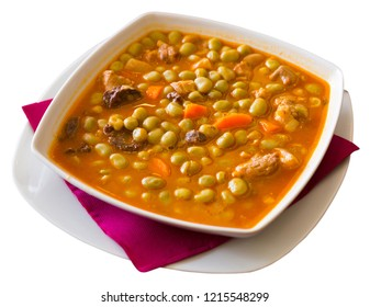 Catalan Beans - traditional dish of Catalan cuisine with tender beans, meat, black sausage and vegetables