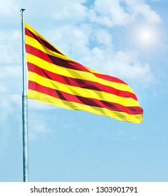 Catalan flag Aerial view. Catalunya flag waving in the wind in Montjuic castle fortress Barcelona, Spain
