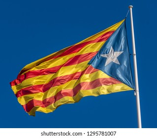 9273605ad05 Catalan flag in support of the independence of Catalunya flies above Girona  with blue sky background