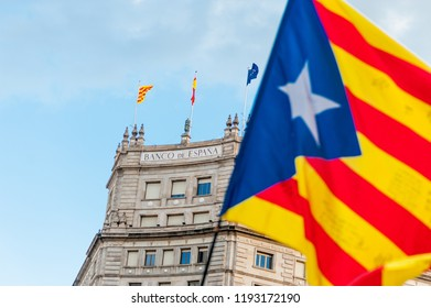 catalan flag waving in front of bank of spain building in barcelona city center during indepence march in october