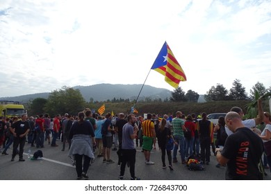 Catalan people cutting the road ap7 to reject the violence in the referendum. Cardedeu, Catalonia October 3 2017