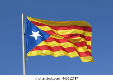 The Catalan separatist independence flag waves proudly in a cloudless blue sky