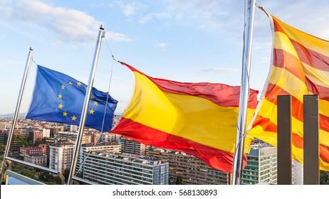 Catalan, Spanish, EU flags flutter over Barcelona city