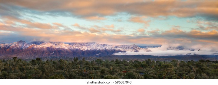 The Catalina Mountains located in Tucson, Arizona seen here as a panoramic covered in their first winter snow at sunrise.