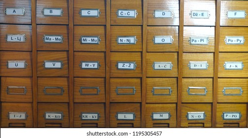 Catalog for catalog cards in library. Wooden catalog in library, with letters on the box, front view