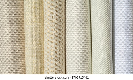 Catalog of fabric in white beige shades. Fabric sample. Industry background. Texture