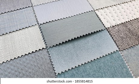 catalog of interior luxury fabric sample chart showing multi texture and pattern of fabric in light green and pastel beige color tone. interior drapery and curtain samples palette.