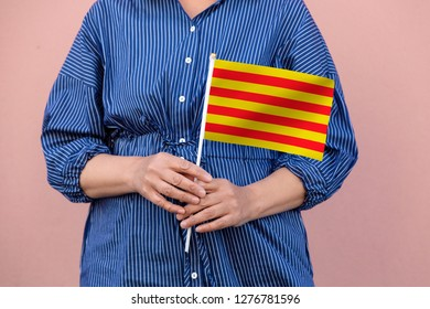 Catalonia flag. Close up of hands holding national flag of Catalonia.