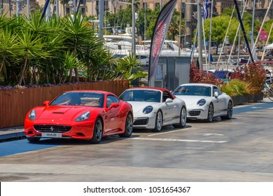 CATALONIA SPAIN - JUNE 2017:  Ferrari California and Porsche 911 Sport cars parked at the Port of Barcelona city, Spain, Europe.