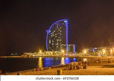 CATALONIA, SPAIN - JUNE 2017: W Barcelona is an amazing 5 star luxury hotel, it has a glass sail like structure and it is located at the end of Barceloneta Beach. The hotel is also known as Hotel Vela
