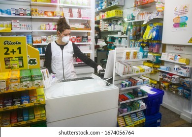 Mataró, CATALONIA, SPAIN. March 16 2020. Pharmacist working. Protection in pharmacies. Working in an Alarm State. Protection against coronavirus.