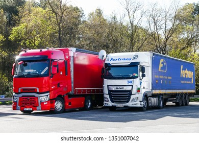 Catalonia, Spain - March 9, 2019: Semi-trailer trucks Renault T and DAF XF at the interurban road.