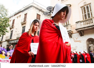 Mataró, CATALONIA. SPAIN. November 25, 2018. Feminist performance of The Handmaid's Tale. Women dressed in red in silent protest. Against sexist violence.
