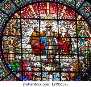 CATALONIA, SPAIN-OCTOBER 18:  Stained glass Jesus crowning Mary God the father in rose window basilica inside Monestir Monastery of Montserrat, Barcelona, Catalonia, Spain on October 18, 2012.