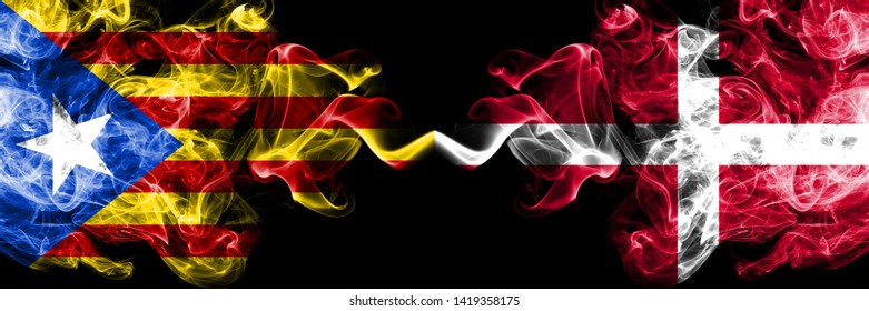 Catalonia vs Denmark, Danish smoke flags placed side by side. Thick colored silky smoke flags of Catalonia and Denmark, Danish