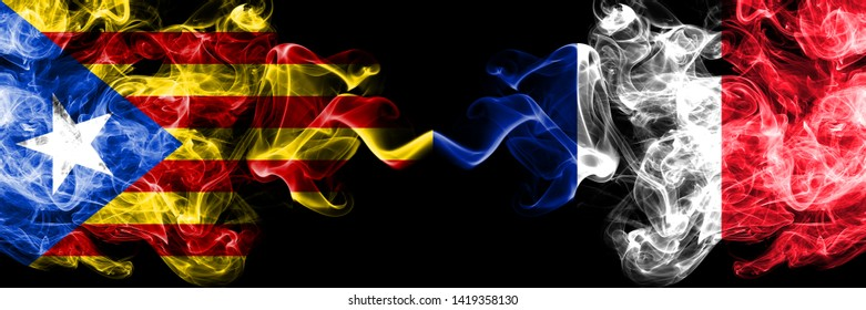 Catalonia vs France, French smoke flags placed side by side. Thick colored silky smoke flags of Catalonia and France, French