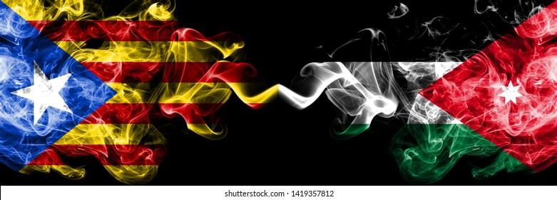 Catalonia vs Jordan, Jordanian smoke flags placed side by side. Thick colored silky smoke flags of Catalonia and Jordan, Jordanian
