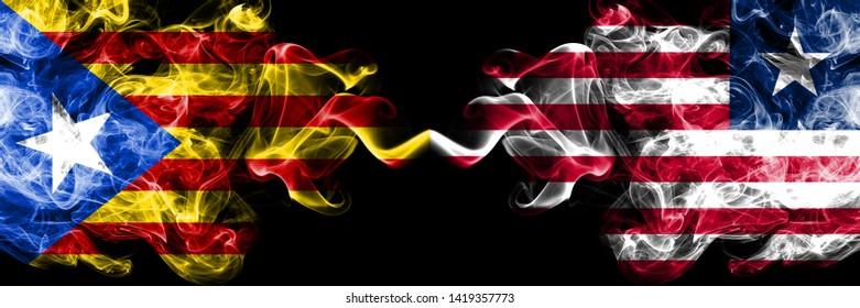 Catalonia vs Liberia, Liberian smoke flags placed side by side. Thick colored silky smoke flags of Catalonia and Liberia, Liberian