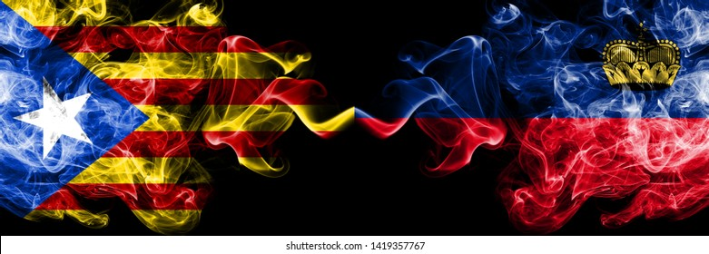 Catalonia vs Liechtenstein, Liechtensteins smoke flags placed side by side. Thick colored silky smoke flags of Catalonia and Liechtenstein, Liechtensteins