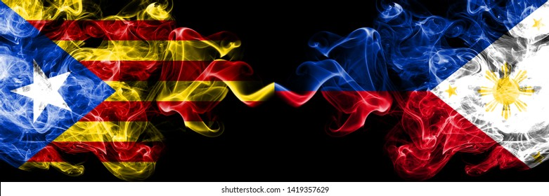 Catalonia vs Philippines, Filipino smoke flags placed side by side. Thick colored silky smoke flags of Catalonia and Philippines, Filipino