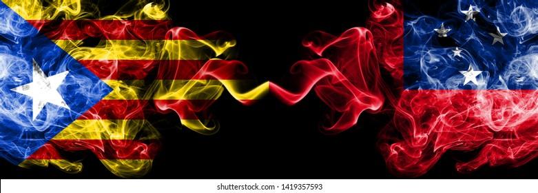 Catalonia vs Samoa, Samoan smoke flags placed side by side. Thick colored silky smoke flags of Catalonia and Samoa, Samoan