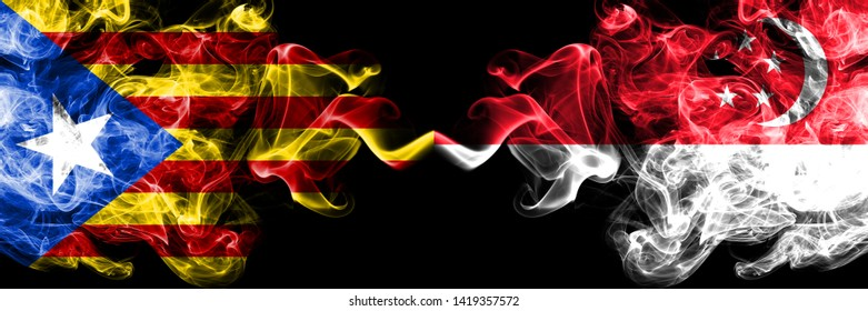 Catalonia vs Singapore, Singaporean smoke flags placed side by side. Thick colored silky smoke flags of Catalonia and Singapore, Singaporean